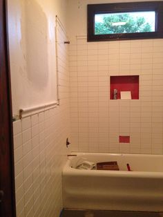 In progress: matte white subway tile and chair rail