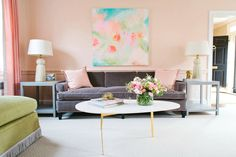 stunning pink pastel living room with pops of green and turquoise