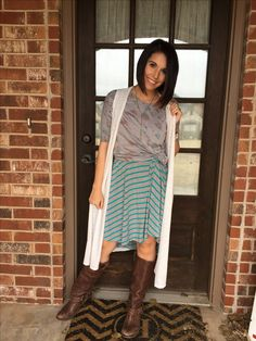 Lularoe Carly layered with a lularoe Irma knotted and a joy vest