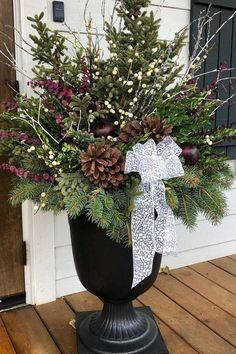 """A beautiful plum, silver and white winter planter arrangement by designer Gretchen Hubbe using the 23"""" Crescendo Urn from the TierraVerde collection of planters made with recycled rubber. A non-traditional color pallet for holiday planters extends the arrangement into January and February! TierraVerde planters are unbreakable due to their rubber material content, and will not crack in winter weather - tested to -40 degrees! Winter Planter, Sugar Plum Fairy, Rubber Material, 40 Degrees, Recycled Rubber, Color Pallets, Winter White, Urn, Timeless Design"""