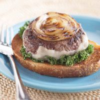 Bull's Eye onion burger:  ingredients  1  large sweet onion  1  pound 95% lean ground beef  1 1/2  teaspoons garlic powder  1/4  teaspoon salt  1/4  teaspoon ground black pepper  4  slices low fat Swiss cheese (3 ounces)  8  red and/or green kale leaves, stems removed  2  teaspoons olive oil  4  3/4 slice hearty bread or Texas toast, toasted