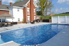 18 x 36 vinyl liner pool with outdoor kitchen area by Brooks Malone.
