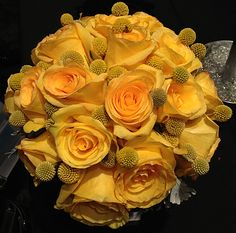Gorgeous golden bridal bouquet of yellow roses and yellow craspedia. Simple and beautiful.