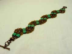 """Funky """"snake"""" tile bead bracelet!  Soft and flexible with a gorgeous sparkle to it!  $34"""