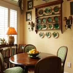 A beautiful green majolica collection in a gorgeous plate rack. I like how the plates are not confined to the rack. The fabric on the chairs and wonderful polished table complete a great look. French Country Style, French Country Decorating, English Style, Dining Area, Kitchen Dining, Dining Rooms, Cozy Kitchen, Kitchen Redo, Dining Table
