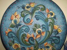 """Rosemaling - """"rose painting"""" - this is a traditional style of art from Norway painted by artists with limited training. I saw a lot of this when I lived in North Dakota and it's very beautiful. It almost died out in Norway but Norwegian descendants in the USA have revitalized it."""
