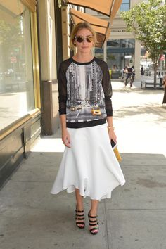 Olivia Palermo represents NY in a cool sweater and flowy midi skirt. // #Celebrity #StreetStyle