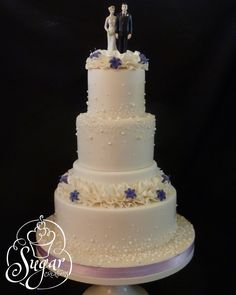 https://flic.kr/p/dy4KFE | ruffles & pearls wedding cake | lots of ruffles & pearls . . . . I meant to take a photo of the back side of the topper the bride provided.  The bride was pinching the groom's rear.  LOL
