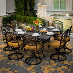 Square tables are a great way for everyone to be included in the conversation.  Evangeline 8-Person Cast Aluminum Patio Dining Set