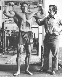 Glory days: Muscleman Schwarzenegger is shown in 1970 training for the Mr. Olympia bodybuilding contest with Gold's Gym founder Joe Weider