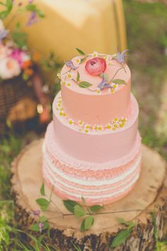 pink wedding cake with florals // photo by nbarrett photography