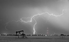Eastern plains of the Rocky Mountain front range Weld County, Colorado, view of a pumpjack near the town of Dacona with a lightning thunderstorm strike near by. Black and white with selective coloring.   #Nature #FineArt #Photography #artwork #Gallery #interiordesign #commercialart - #Photo #Art from #Colorado to decorate your office, home, restaurant, boardroom, waiting room or any commercial space starting at $22 - #CorporateArt by #Photographer Copyright James Insogna www.BoInsogna.com