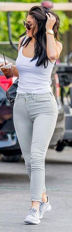 Kylie Jenner: Purse – Givenchy  Watch – Rolex  Bracelet – Cartier  Shoes – Nike  Shirt – American Apparel