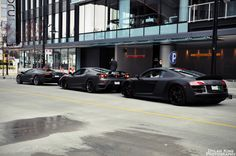 death row with a murdered out Lambo, Ferrari and R8