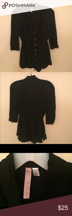 Classic Black Blouse Gorgeous dressy blouse! Has a tie back to adjust the fit of the waist. Buttons up the front & the ruffle detail on the top gives it a very soft, feminine look. Machine washable & in great condition. Tops