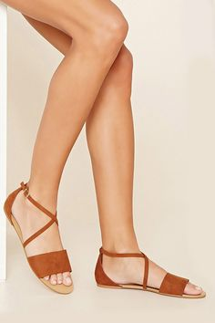 Style Deals - A pair of faux suede open-toe sandals with crisscross top straps that buckle at the ankle.