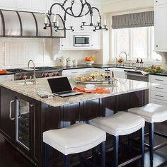 White and Brown Kitchen with Crema Persa Granite Countertops