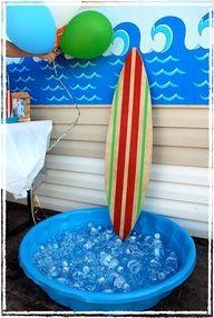 water bottles in kiddie pool with surf board