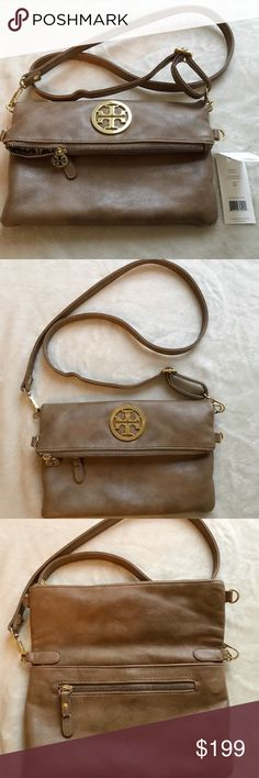 Tory Burch Foldover Crossbody Bag Authentic Tory Burch Foldover Crossbody bag. The color is Tan. This bag comes with it's original tag. It does have some signs of wear near the bottom. No dust bag included. I have a no smoke, no pet, no children household. Let me know if you have any questions at all. Thank you for viewing! *No Trades : ) * Tory Burch Bags Crossbody Bags