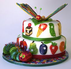 Someone did, almost, exactly what I was planning on doing for Coraline's first birthday cake...looks like I'll have to change it up a little.  THis is gorgeous: Elaine's Sweet Life: The Very Hungry Caterpillar Cake