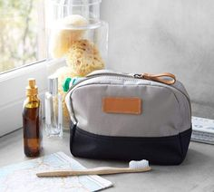 Pack up your makeup, travel essentials or whatever you need on-the-go. This pouch crafted with durable nylon that will look chic from point A to point B. Travel Necessities, Travel Essentials, Saddle Leather, Leather Handle, Baby Toiletries, Large Storage Baskets, Laundry Hamper, Look Chic, Makeup Yourself