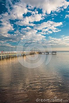 Photo about pier at sunset in Jurata, Poland. Image of beautiful, travel, tourism - 120067624 Poland, Tourism, Stock Photos, Sunset, Beach, Water, Travel, Outdoor, Image