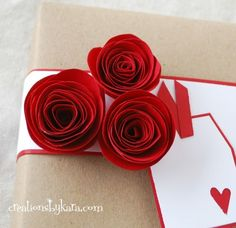 Rolled paper roses from @Kara Cook (Creations by Kara).  Gorgeous! #giftwrap #roses