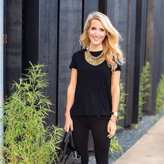 Black skinny jeans, black tee, statement necklace, cream express purse, black pointy flats