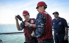 CORONADO, Calif. (May 1, 2014) Gunner's Mate 2nd Class Erin O'Hara, left, explains shot line operations to Gunner's Mate Seaman Michael Griffis on board the aircraft carrier USS Nimitz (CVN 68). Nimitz is pierside at Naval Air Station North Island in Coronado, Calif. (U.S. Navy photo by Mass Communication Specialist Seaman Aiyana S. Paschal/Released)