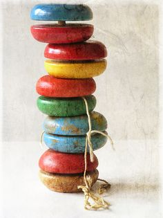 Yo Yos were all wood until the later 50s when they started to make them in fiberglass and plastics.