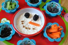 Build-A-Snowman with Cottage cheese face, carrot stick nose, berry eyes, nut or seed mouth.  Lots of choice with this one.