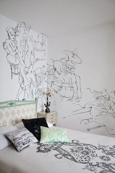 Graphic bedroom with Didier Mahieu's drawing on the wall and set of bed linen by Carolyn Quartermaine