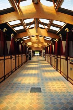 Horse barn (indoor stables) with a quarry tile floor on the aisle.