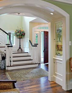 Great entry - More wood stain around the white moldings for me but a great design.