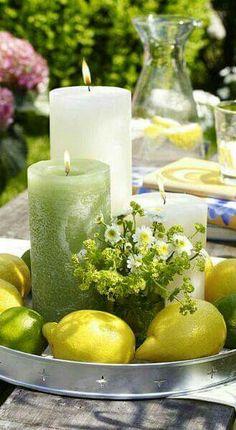 Small Flower Arrangement as part of al fresco vignette with lemons, limes, candles