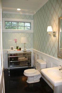 Dark wood floors, white sink, mirrored chest <3