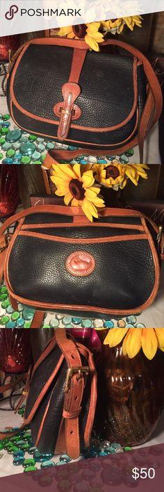 Dooney & Bourke Bag Authentic Dooney & Bourke- Sz 11x8- 24' strap- Good condition- Can be worn as a Crossbody- Black/Tan- Interior pocket- Very nice bag. Dooney & Bourke Bags Shoulder Bags