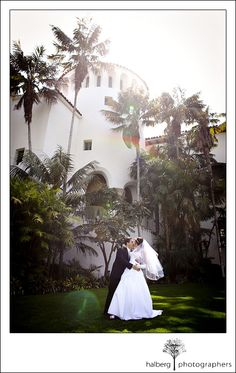 bride and groom kissing in garden after their santa barbara courthouse wedding