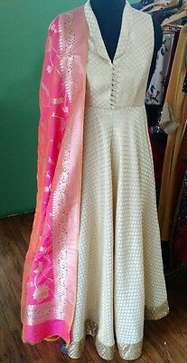 Beige Silk Anarkali with hand embroidered border with contrast Banarasi shocking pink dupatta Indian Gowns, Pakistani Dresses, Indian Wear, Indian Outfits, Indian Clothes, Indian Sarees, Salwar Designs, Blouse Designs, Dress Designs