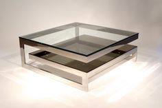Two contemporary mirror-polished stainless steel square coffee tables