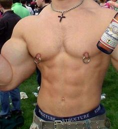 Shirtless body builder parties half naked with his Budweiser in hand, and ginormous nipple rings dangling off his huge male nipples, protruding and perky.