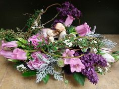 Pink purple flower arrangement for wedding and event