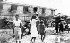 Tacloban, Leyte Island, Philippines, Feb, 21, 1946 by John T Pilot: knee length, one-piece dress