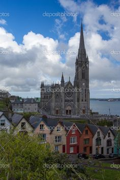 St. Colman Cathedral in Cobh near the ocean with colorful houses, County Cork, #Ireland