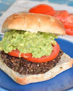This veggie burger is chock full of flavor and texture, packed with quinoa, black beans and mushrooms. It's topped with a creamy avocado-tomatillo guacamole!