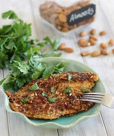 This dijon almond crusted tilapia is pan-fried, ready in 10 minutes and a healthy, grain free dinner. It's perfect for a quick weeknight meal.