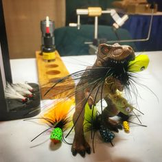 My tying mascot Rexy, with assortment of poppers I painted and tied for a sport show this weekend.