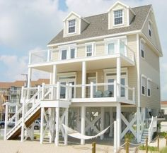 Coastal home plans mackay 39 s cottage love the mud room for Modular homes on pilings