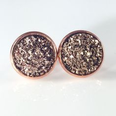 3 for 15 rose gold flat Druzy style earrings New! Handmade by me 1/2 inch, 12mm faux acrylic druzy in rose gold tone earrings. Rose gold backings. PRICE FIRM if purchasing 1 pair ($8). No trades.  ➡️TO GET 3 FOR 15 deal⬅️ ✅Click Add to Bundle under any 3 items (marked 3 for 15) ✅Make offer for $15 ✅I'll accept your offer ✅ Additional items $5 each so 4 pairs=$20, 5 pairs=$25, etc. If you need help, let me know  Jewelry Earrings