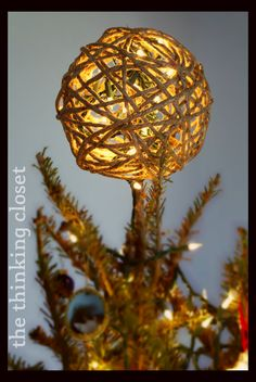 D.I.Y. Twine Ball Tree Topper by The Thinking Closet | Turn a ballon, twine, and a few other household items into a beautiful Christmas tree topper!